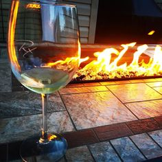 This is the patio view with a custom Marketing Rx wine glass. You can fit a whole bottle of wine in one glass.  I'm serious. I would t recommend it but it's true.  They look like this!  #wine #Marketingrx #summer #patio #fire #wineme #instagood #yeg #happiness #branding #marketing #girlboss #socialmediamarketing #lightthefireofyourbrand