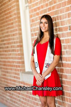 Fun College Senior Graduation Grad portrait photo ideas at Tucson The University of Arizona campus in Tucson AZ Arizona taken by Michael Chansley Photography Cap and Gown college Old Main Fountain group sorority friends guys girls UofA High School group girl guy pose poses photographer idea ideas bottles of champagne sexy hot model cap and gown red dress sash brown hair