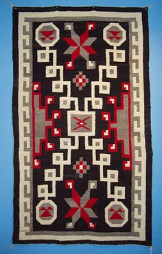Navajo regional rug with a negative modified storm pattern c.1930.