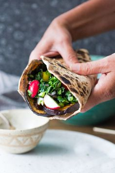 Middle Eastern Eggplant Wrap with a lemony Kale Parsley Mint Slaw with Creamy Tahini Sauce. Keep it vegan or add feta!   http://www.feastingathome.com