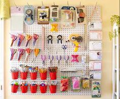 Behind her desk, Leah mounted a large pegboard made out of $5 sections she purchased at the hardware store. Before hanging it on the wall, Leah primed and painted the board white for a crisp look, then outfitted it with different stage hooks, creating a tidy and tailored home for her tools. Make your own version of the calendar hanging in Leah's room in her Create a Calendar class.