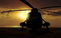 Military helicopter on carrier ship at sunset by razihusin. Military helicopter on carrier ship at sunset