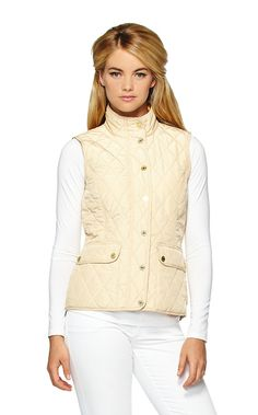"Getaway Quilted Vest - The Getaway thin quilted vest is everything you are been looking for in a feminine vest. This slimming vest comes in rich colors and in true Lilly fashion, a printed lining. There's no need to settle for boring or basic when you can have fun and feminine. Love! Quilted Vest With High-Low Hem, And Patch Pockets And Printed Lining. Front Length - 24 ½"", Back Length - 26"". 100% Polyester."