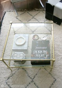 Love the gold on this table, and the double layer to see the items underneath.