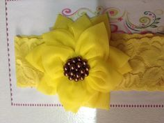 Como hacer una flor de tela en forma de girasol