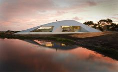 Crescent shaped Croft House with curved roof and windows