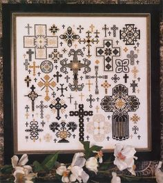 Rosewood Manor Crosses of the Kingdom - Cross Stitch Pattern. Model stitched on 32 Ct. Antique White linen with DMC floss and DMC Light Effects. Stitch Count: 1