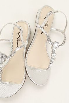 Style meets comfort with these multi stone t-strap sandals! Heel Height Available in Silver Metallic. Fully lined. Turquoise Wedding Shoes, Silver Wedding Shoes, Wedge Wedding Shoes, Silver Sandals, Metallic Sandals, Bridesmaid Shoes, Prom Shoes, Bridal Sandals, Bridal Shoes