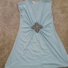 Blue top with large embellishment on from Blue, flowy fabric. Tops Blouses