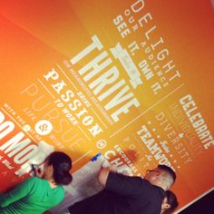 Putting up our Core Values Mural in the LA office