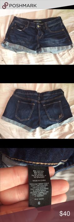 Express dark blue stretchy shorts These shorts are good for those with thick thighs/a bigger bum. They fit my waist but are pretty loose around my thighs. Worn once. Express Shorts Jean Shorts