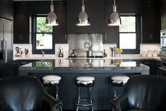 As the ubiquitous all-white kitchen starts to look sterile, designers are thinking inky—with dark cabinetry, appliances and accessories