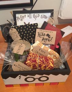 "Ultimate Harry Potter Gift Box -- perfect present for every HP lover. Contents include: -Espresso Patronum (coffee) -Lumos (Candle) -Free Dobby Socks -Bertie Bott's Every Flavor Beans -Tom Riddle's Diary -Griffindor Quidich Shirt -Quiddich Through the Ages  -Dementor's Kiss-Away (chocolate Kisses) -Shots of Felix Felicis, Polyjuice Potion, Veritaserum and Amortentia -""After All This Time...Always"" Picture Frame"