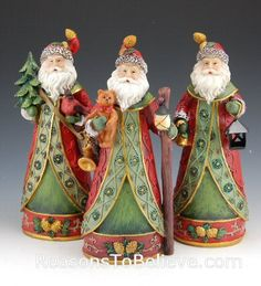 """10"""" Decorative Santas - A set of three Santas, each with different theme. One carries a walking staff and teddy bear, another carries a cardinal and Christmas tree, and the other a lantern and bell. A beautiful trio of Santas. Cast in resin and hand painted."""