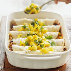 These #vegetarian Enchiladas with Fresh Mango #Salsa are a fresh twist on a classic dish. Get the recipe here: http://www.bhg.com/recipe/beans/enchiladas-with-fresh-mango-salsa/?socsrc=bhgpin0423123Enchiladas