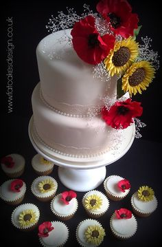 Poppies and sunflowers wedding cake. Hand wired sugarflowers in striking red and yellow, with matching cupcakes.