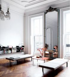 Pier mirrors are long, tall pieces that nestle into the wall space (aka a pier) between two windows.