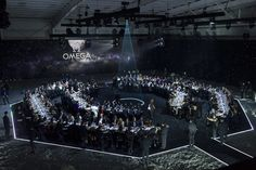 """Bureau Betak transformed the Western Airways Hangar into a spectacular 20,000-square-foot party setting—the Omega Lunar Base—that flowed from the """"space capsule"""" into a dramatic moonscape, where dinner was served beneath a starlit orb."""