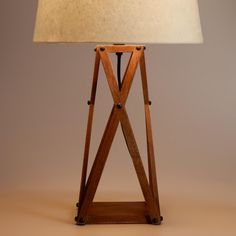 Save: Wood X table lamp base ($60) and solid off-white accent lamp shade ($10), both from worldmarket.com. (worldmarket.com)