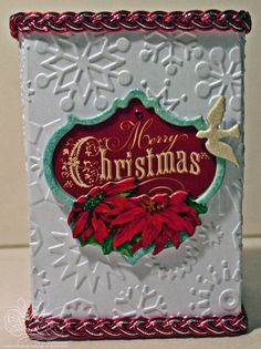 Look at this gorgeous homemade Merry Christmas Luminaria card I found on Scrapjazz.com. She actually installed a battery operated light that flickers on the design when you open the card!!  The designer's name is Karemal, and her creations are amazing!!