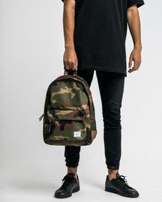 Hight: Width: Depth: Capacity: Signature striped fabric liner Single top handle Front storage pocket Prusik cord zipper pulls Classic woven label Made in Vietnam Composition: Polyester Herschel Supply Backpack, Camo Backpack, Herschel Heritage Backpack, Weekend Hiking, Woodland Camo, Striped Fabrics, Indie Brands, Timeless Design, Your Style