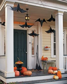 Made out of craft paper, these fluttering winged critters are a great way to welcome trick-or-treaters in hair-raising style by turning your front porch into a bat cave. #marthastewart #halloween #halloweendecor #diyideas #diyhalloween