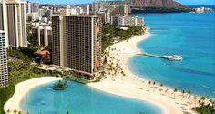 The majestic exterior of #Hilton Hawaiian Village Waikiki Beach Resort in Honolulu, Hawaii is a focal point of the expansive coastline.