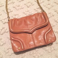 Rebecca Minkoff crossbody Such a cute cognac leather mini crossbody by Rebecca Minkoff. Great condition, but the inside does have some staining (probably from lotion or something). Hard to show in the photo. Small purse, great for a night out. Rebecca Minkoff Bags Crossbody Bags