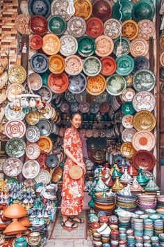 Morocco Travel Photography: 35 Photos To Inspire You To Visi.- Morocco Travel Photography: 35 Photos To Inspire You To Visit A woman in a red dress stands in the doorway of colourful ceramics in the souks of Marrakech, Morocco - Visit Morocco, Morocco Travel, Marrakech Morocco, Africa Travel, Travel Europe, Travel Photography Tumblr, Photography Beach, Photography Photos, Sri Lanka