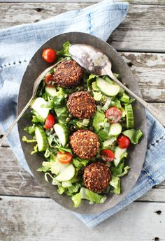 Falafel Salad- 1 3/4 cup chickpeas, 2 cloves garlic, 1 yellow onion, 1 handful parsely, 1 tsp cumin, 1 tsp coriander, 1/4 tsp cayenne, 1/2 tsp baking soda, 1 tsp salt, 2 tbl lemon juice, 1-2 tsp flour, 1/4 cup sesame seeds Dressing: 1/4 cup oil, 2 tbl lemon juice, 1/4 cup coconut yogurt, 1 tsp sugar, 1 tbl apple cider vinegar, salt Salad: romaine lettuce, cherry tomatoes, cucumber, onion