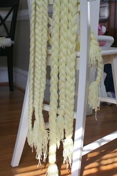 Rapunzel party. Making yarn hair like this and a blown up photo of rapunzel would be a great idea for a tangled themed party.