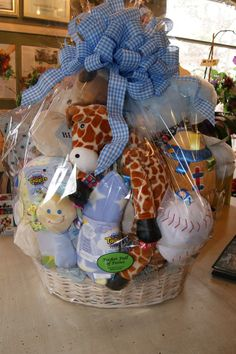 Custom baby baskets available at Pocket Full of Posies Florist & Gifts (Galloway, New Jersey 08205). Pricing starting at $50.00. Taggies, Mary Meyer, Zoobies, Stuffed Animal, & Vera Bradley Baby all in stock!