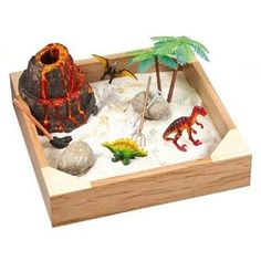 want to make one for my son with things we already have around the house:  mini dinosaur tube playset, sand, and a small plastic storage box with a lid.