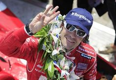 Dario Franchitti's crew races to right his car after the driver spun as he entered his pit box early in the race. Race fans pour in to the Indianapolis Motor Speedway for the 96th running of the Indy 500 May 27, 2012. / Doug McSchooler/The Star
