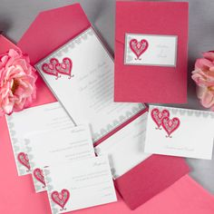 Cherished Hearts Fuchsia Pocket -  A bright white invitation is layered on top of a silver backer. A double heart design is featured accented by a border design in sterling. The shimmer fuchsia pocket is perfect for adding your matching enclosures.