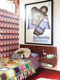 Multicolored proof that more is more: Annie Price and Jamie Peterson's crazy-cool kids' room, decorated with wallpaper from Etsy, a crocheted quilt, and a vintage poster from a local shop.