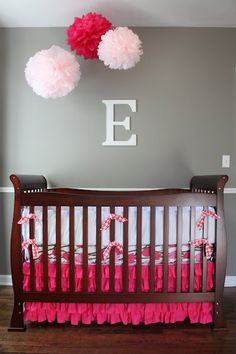 Just love this - the grey wall, the white letter, the pink accents and the poms! Want to figure out how to make the ruffled bedskirt, too...