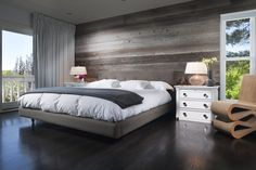 The smooth floor is very chic and the horizontal lines across the back panelling make the room look bigger. The bed is low to the floor and looks very comfy. Option B for  bed. Option C wall.