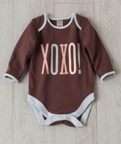 Wrap baby in hugs and kisses with this soft cotton bodysuit exclusively from Hallmark Baby.
