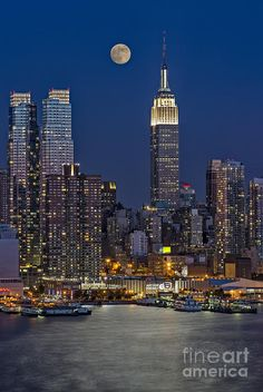 The Empire State Building and surrounding buildings at dusk, with the Hudson River lit by the light of the full moon, as seen from Weehawken, New Jersey. New York City NYC. Empire State Building, Places Around The World, Around The Worlds, Beautiful World, Beautiful Places, Places To Travel, Places To Visit, I Love Nyc, City Aesthetic