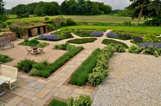 The Potager    My clients fell in love with the idea of a potager – but nothing too formal – they wanted a design that would open up views to the surrounding Suffolk countryside, complement the fabulous barns and former piggeries and provide a new seating area close to the house and one