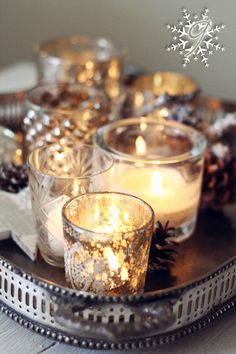 I really like the silver candle holders on the old silver tray