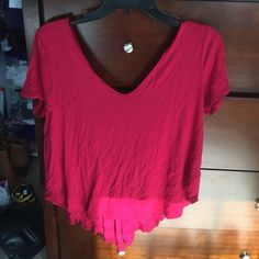 shirt red, open crossed back (pic two), good condition except two small holes on right breast area -- lower price PacSun Tops Tees - Short Sleeve