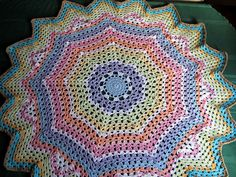 This very pretty afghan will make an awesome gift for any new mother. Use scraps or plan your color sequences. I used random coloring and it still turned out great!