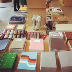 Stationery and book table by poketo, via Flickr