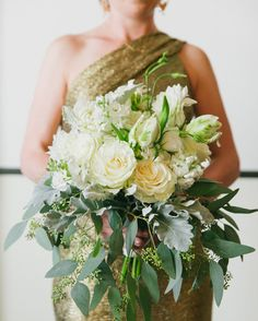 To help her stand out from the other bridesmaids, Blossom and Branch made this maid of honor a slightly larger bouquet of parrot tulips, seeded eucalyptus, dusty miller, dahlias, roses, and white stock.