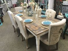 Beautiful farmhouse table seats up to eight depending on chair size. Table top lightly painted in mix of white, gray and natural wood tones. A great piece to add as your dining table. Available to ord