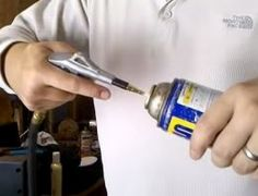 Aerosol Can Recharging - Homemade aerosol can recharging done by introducing compressed air using a custom nozzle.