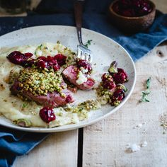 Pistachio Crusted Lamb Chops with Red Wine Cherries and Polenta