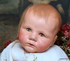 Rare circa 1930's Du Mein Magnesite Kathe Kruse baby sodl by Signature Dolls.